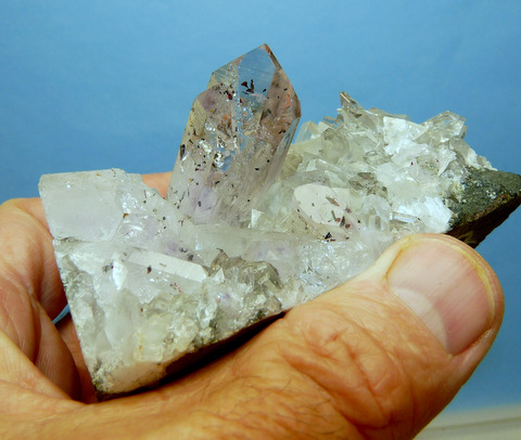 Lovely harlequin quartz crystal with other crystals, on matrix