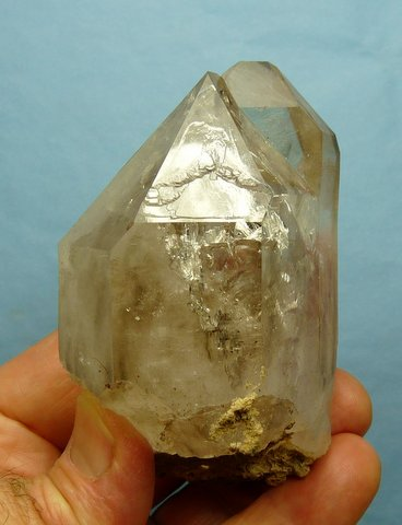 Large quartz crystal with gas inclusions and twin female terminations