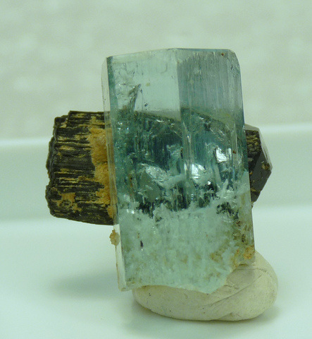 Aquamarine crystal with gemmy upper half, with schorl and feldspar crystals