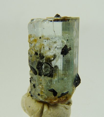 Pale blue aquamarine crystal on schorl crystal cluster