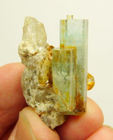 Aquamarine crystals on quartz