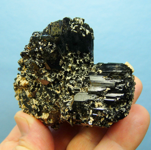 Schorl crystal group, sprinkled with feldspar