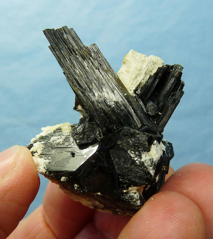 Jet black schorl crystals on white feldspar matrix, floater