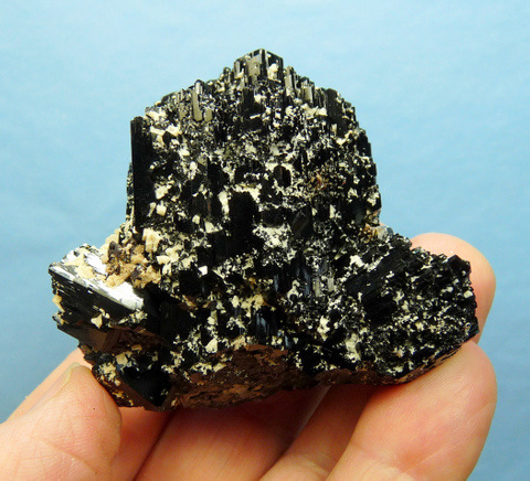 Schorl specimen with lovely facets and feldspar