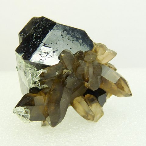 Schorl crystal group with feldspar at the bottom