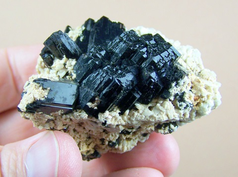Cluster of lustrous schorl crystals and feldspar