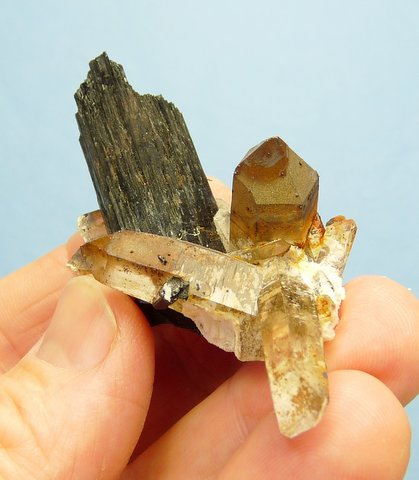 Group of quartz crystals with schorl crystals, feldspar and (?)goethite