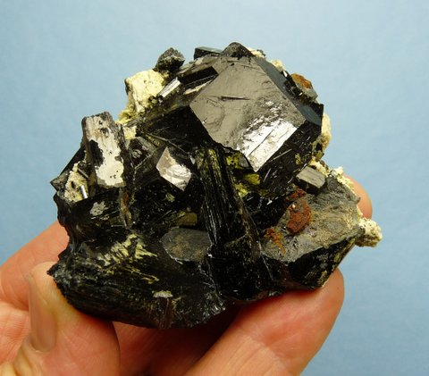 Schorl crystal cluster with bits of feldspar and a yellowish mineral