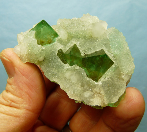 Well-formed green fluorite pyramids with quartz