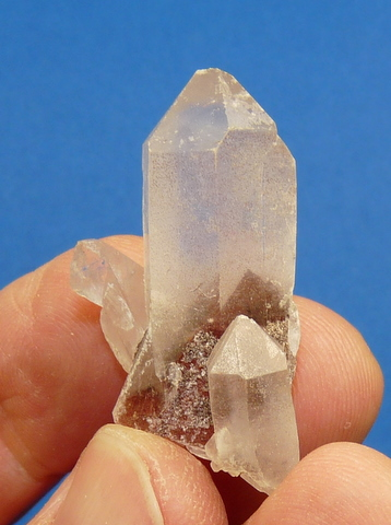 Quartz crystal group wit a brick-red phantom