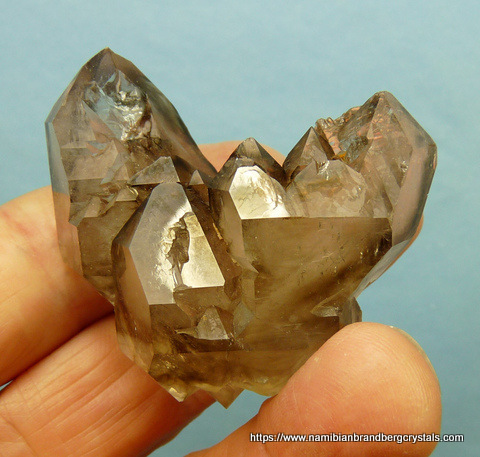 Zoned purple fluorite crystals on phantom quartz crystals