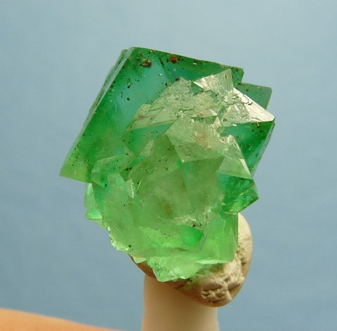 Small cluster of vivid green fluorite crystals with minute pyrite crystal inclusions