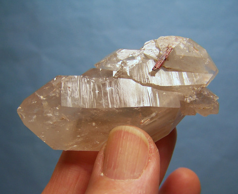 Quartz crystalcluster with light smoky colouring and rutile needles