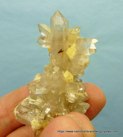 Double terminated quartz crystal with feldspar and rutile