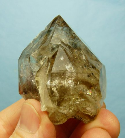 Gemmy quartz crystal with interesting facets and a window